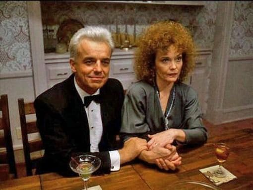 Leland Palmer and Sarah Palmer at the dinner table at the Hayward household. Leland is wearing a tuxedo.