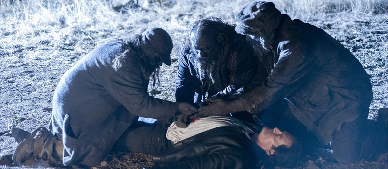 After Ray shoots Mr. C., three filthy Woodsmen appear and begin to revive him.