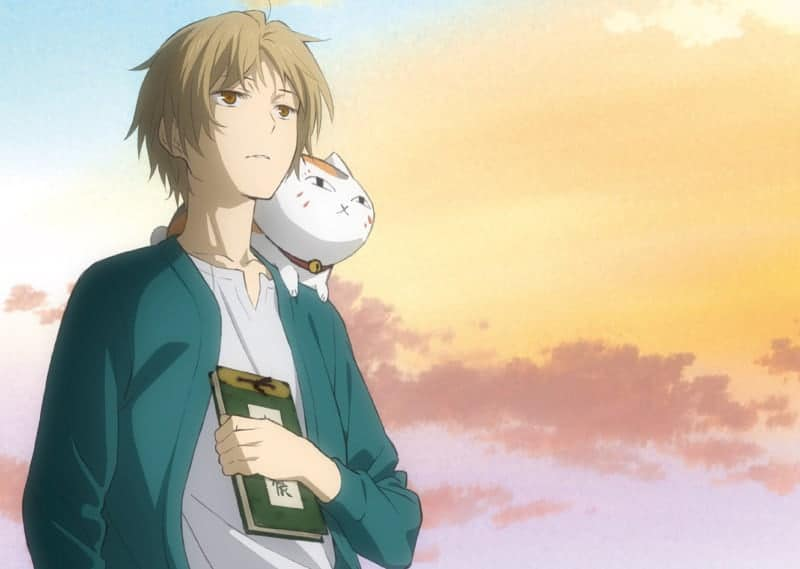 Takashi and Nyanko-sensei stare into the sunset in this promo image for NATSUME'S BOOK OF FRIENDS: TIED TO THE TEMPORAL WORLD.