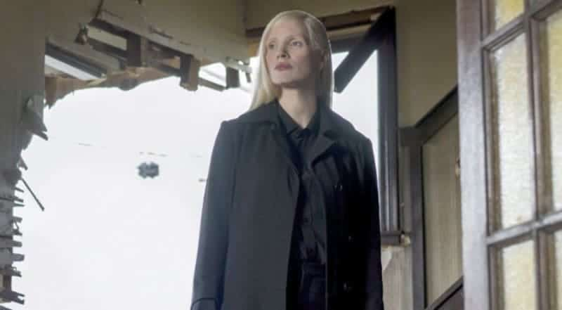 Jessica Chastain's character stands by dressed in black